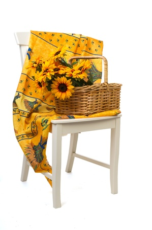 Romantic still life with a basket sunflowers on a white chair with French Provence design photo
