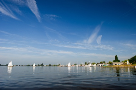 plassen: Water with sailboats and recreational harbor in Holland