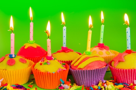 Colorful cupcakes with burning candles and confetti Stock Photo - 10010816
