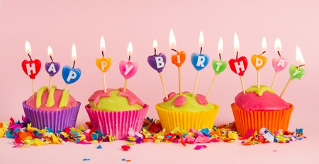 Cup cakes with burning happy birthday candles Stock Photo - 10010802