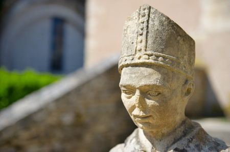 munch: Old French sculpture of a Benedictine munch at the abbey in Tourtoirac