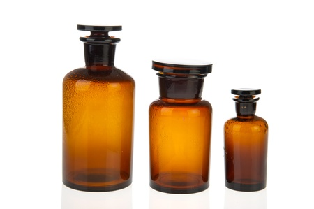 bigger: Three brown glass pharmacy bottles isolated over white background Stock Photo