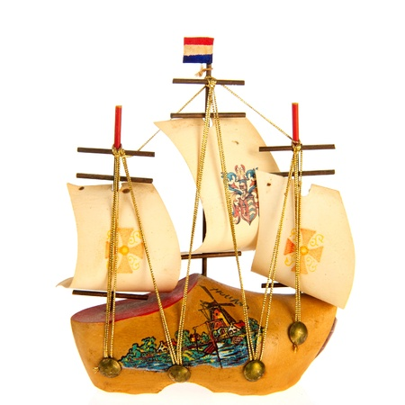 Dutch sail boat made of a wooden clog photo