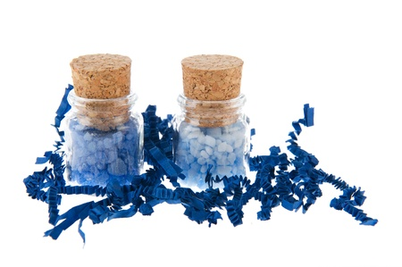 closed corks: Glass bottles with blue bath salt isolated over white background Stock Photo