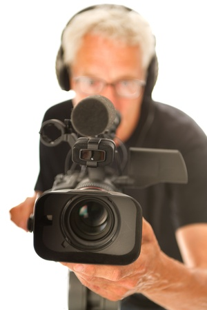 Professional video camera man with focus on objective