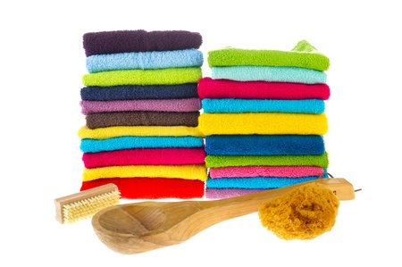 Stacked colorful towels isolated over white background photo