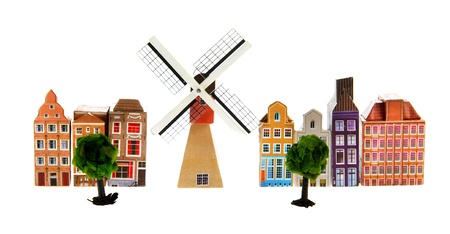 Typical Dutch village with windmill isolated over white background photo