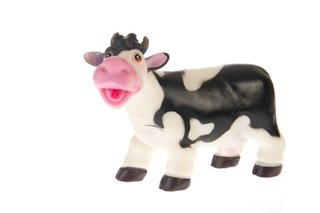 Plastic black and white cow on white background Stock Photo - 10639874