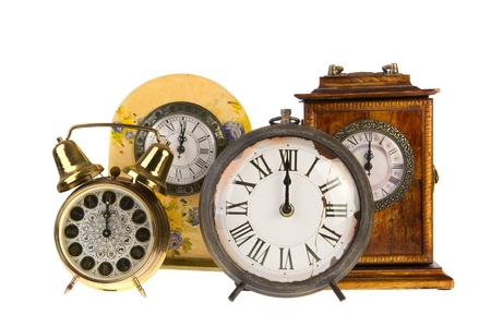 All vintage clocks at twelve hours isolated over white photo