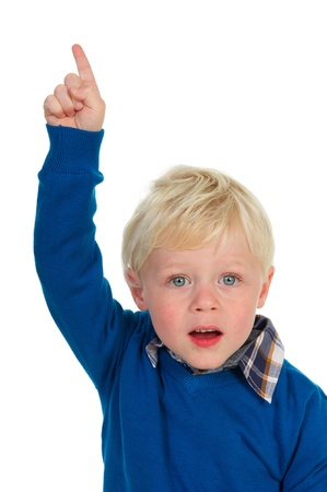 Little blond toddler is pointing upward photo