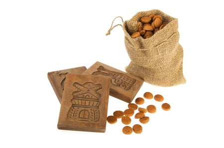 pepernoten: Traditional Dutch Sinterklaas attributes as Speculaas boards and pepernoten Stock Photo