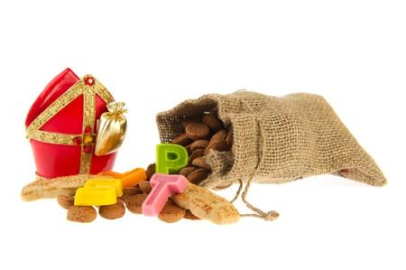 pepernoot: Traditional Dutch Sinterklaas in jute bag with marzipan and pepernoten Stock Photo