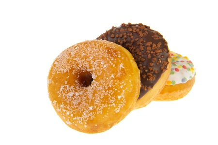 sugary: Three sugary sweet donuts with glaze isolated over white background