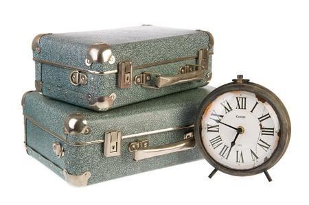 old times: Los viejos tiempos con maletas de �poca y el reloj Foto de archivo