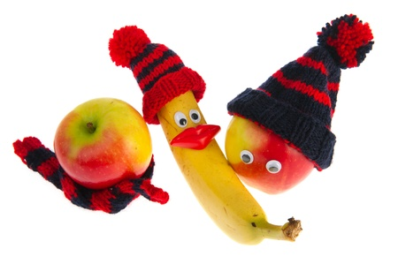 Funny winter fruit with hats and scarfs photo