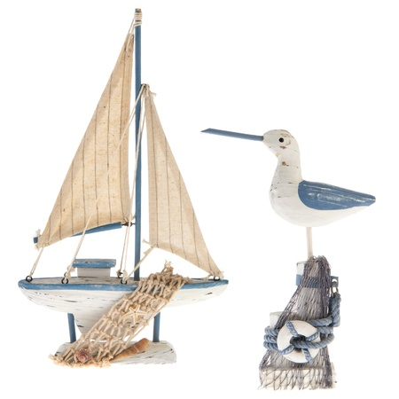 sports shell: Old white and blue miniature sailboat with sea gull Stock Photo