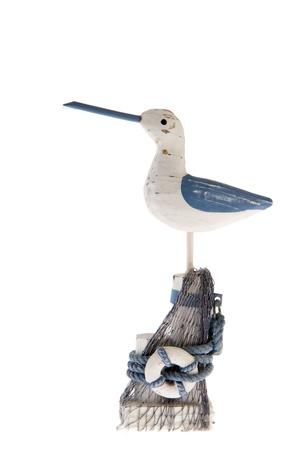 bollard: Wooden sea gull standing on a bollard
