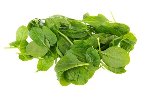 Fresh green spinach isolated over white background photo