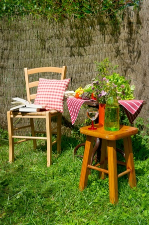 Seats and table in a quiet corner of the garden photo