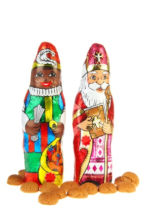 pepernoten: Dutch chocolate Sinterklaas and Black Piet with pepernoten Stock Photo