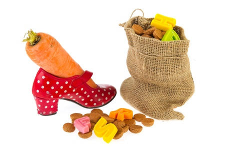 Bag full with Dutch Sinterklaas candy and shoe with carrot photo
