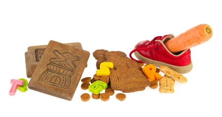 Traditional Sinterklaas candy and shoe with winter carrot Stock Photo - 11263589
