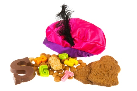 pepernoot: Dutch Sinterklaas candy as pepernoten and chocolate letter with hat of Black piet