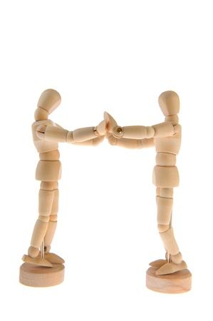 Wooden dolls together in love isolated over white background Stock Photo - 11263560