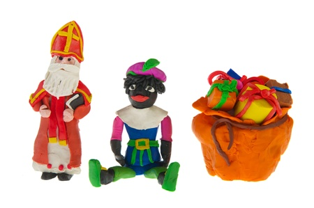 selfmade: self-made Dutch Sinterklaas and Black Piet from clay isolated over white background
