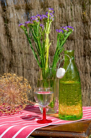 Bottle drinking water and glass outdoor in still life photo