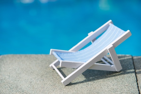 lounger: Lounge chair near the swimming pool Stock Photo