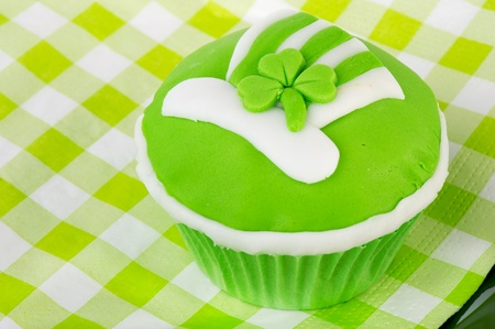 Green cupcake with head and shamrock for Saint Patricks day photo