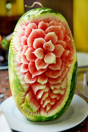 fruit stand: beautiful artful carved melon for decoration at the buffet