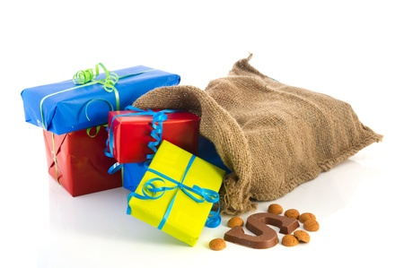 Jute bag full of Dutch Sinterklaas presents with neutral wrapping paper Stock Photo - 11473035