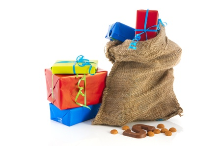 Jute bag full of Dutch Sinterklaas presents with neutral wrapping paper photo