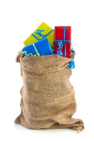 sinterklaas: Jute bag full of Dutch Sinterklaas presents with neutral wrapping paper