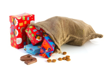 Jute bag full of Dutch Sinterklaas presents with colorful wrapping paper photo