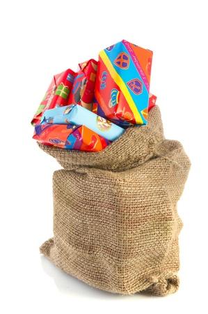 sinterklaas: Jute bag full of Dutch Sinterklaas presents with colorful wrapping paper Stock Photo