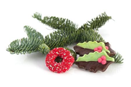 coronas navidenas: Navidad y guirnaldas de acebo del chocolate Foto de archivo