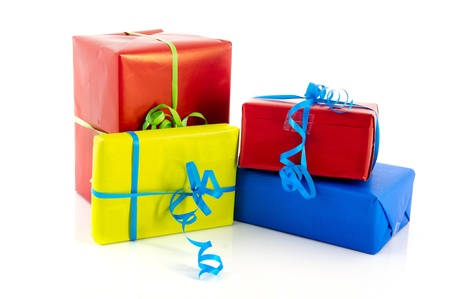 Colorful wrapped presents with ribbons isolated over white background Stock Photo - 11473102