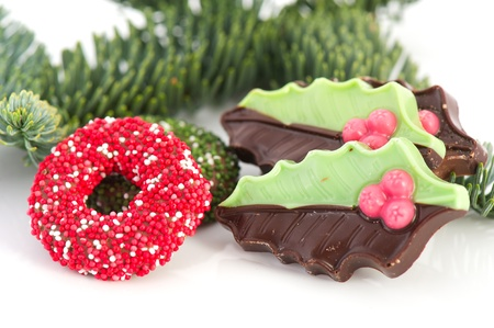 christmas wreaths: Christmas wreaths and holly from chocolate Stock Photo