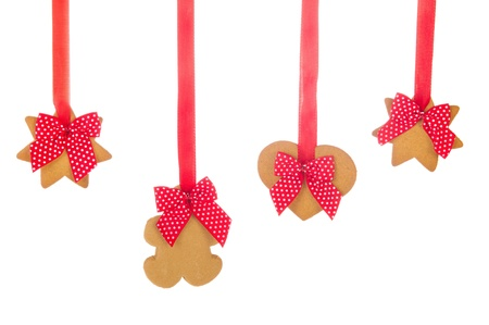 Hanging Christmas ginger bread cookies with ribbons and bows photo