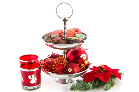 Christmas still life with silver tray chocolate and ornaments photo