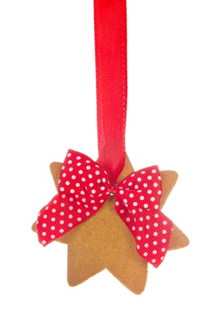 Hanging Christmas ginger bread star isolated over white background photo