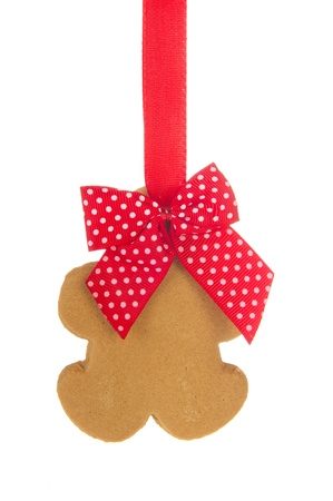 Hanging ginger bread man isolated over white background photo