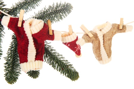 Detail from a Christmas tree with hanging clothes from Santa Claus photo