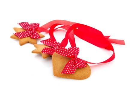 Ginger bread cookies with red ribbon isolated over white background photo