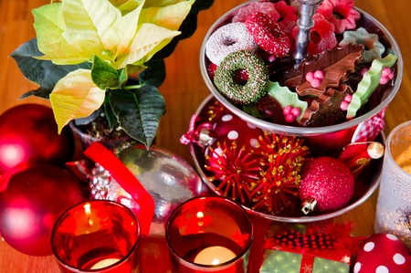 Christmas still life with chocolate sweets and Poinsettia photo