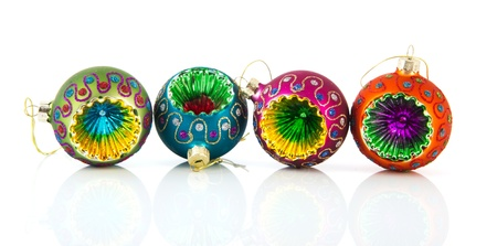 Colorful Christmas balls in a row isolated over white photo