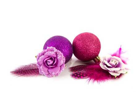 pink Christmas decoration with feathers isolated over white background photo